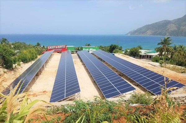 Image curtesy of EarthSpark International. 100kW microgrid system with solar + batteries + diesel back up. Servicing 500 households in Tiburon, Haiti.